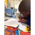 Adonai writing a pirate party invitation.
