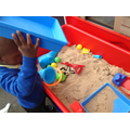 Sange filling and pouring in the sand tray