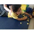 Lois having tummy time whilst exploring pasta