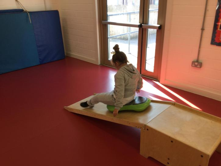 Learning how to use a scoot board.