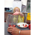 Ruby joined in making fruit smoothies