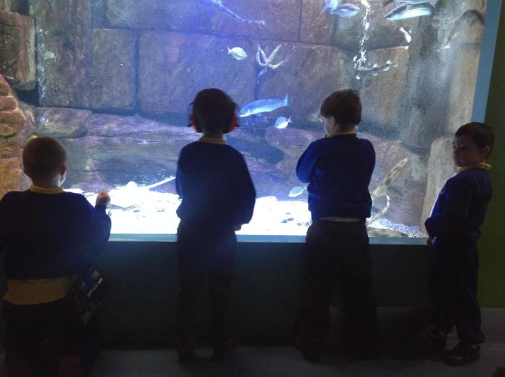 standing with our peers enjoying the fish