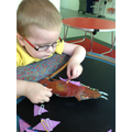 Zac clipping purple prickles onto the Gruffalo