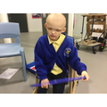 Poppy enjoyed exploring the hula hoop when learning about circles!