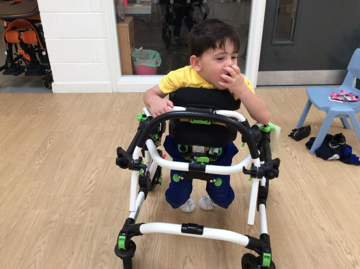 13/10 Brandon trying his walker out in school