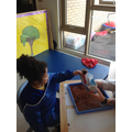 Charlotte chose what she wanted to use in the mud tray.