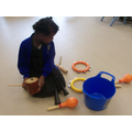 Hafsa exploring the instruments