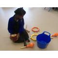 Hafsa exploring the instruments