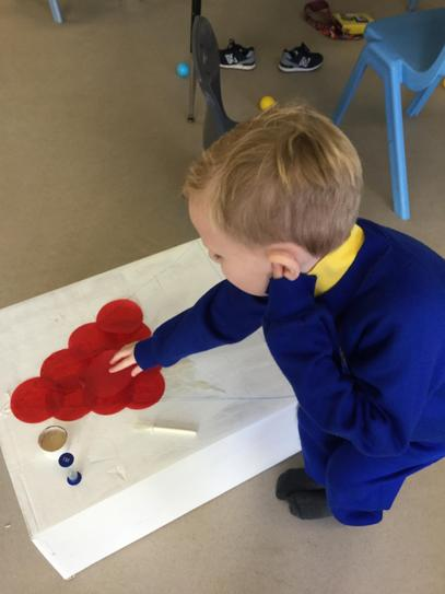 Francis helping make decorations for our stall.
