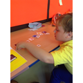 Elliot matched the symbol sentences to the pictures.