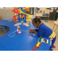 Hafsa using the remote control robot
