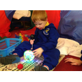 Liam enjoying the sensory materials form the story