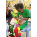 Hafsa 'feeding' the baby its bottle