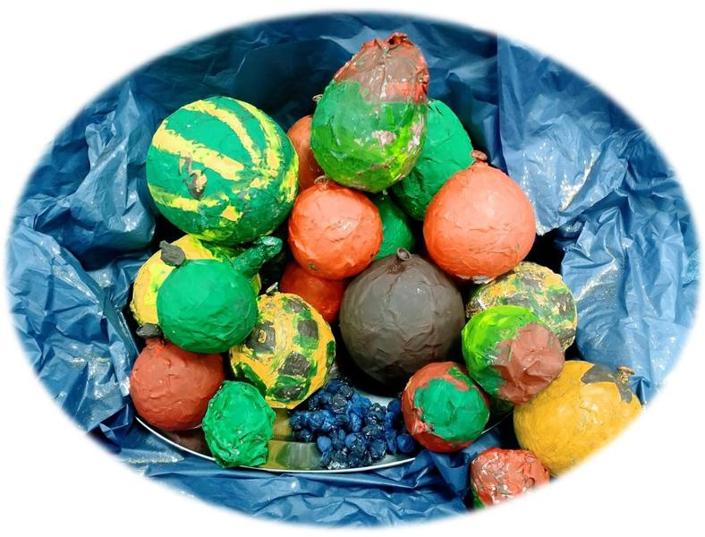 We used paper mache to create our Harvest fruits and veggies