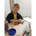 Working with equipment to solve maths problems