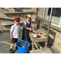 Whipping up a storm in the mud kitchen!