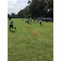 Children racing over hurdles