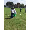 Children in a bean bag race