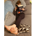 Relaxing on the sofa with a good book - looks like a fantastic choice!