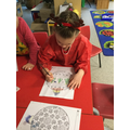 We explored using water paints to colour our baubles