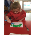 We used brushes and cotton buds to create a Christmas wreath