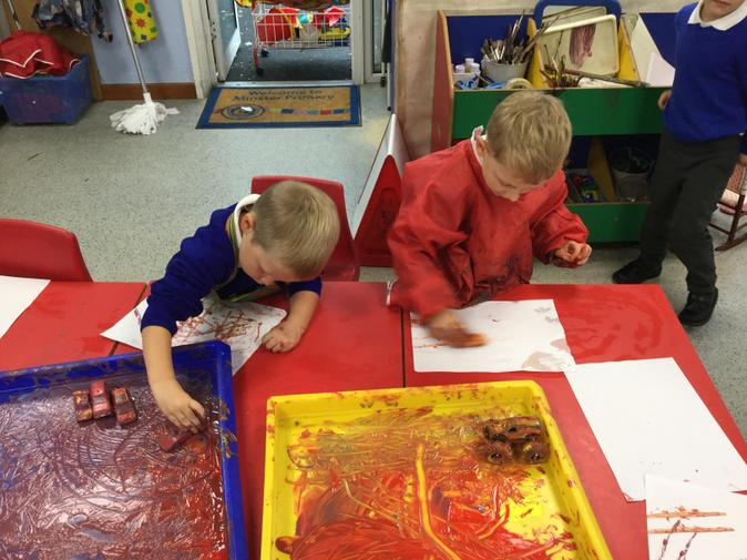 We explored mark making with cars in the paint