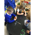 We used tweezers to pick up and move gems onto the numbers
