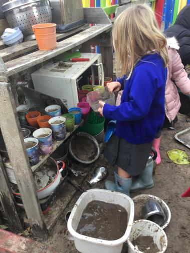 Cooking up a treat in the mud kitchen