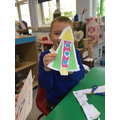 Cutting and sticking 2D shapes to make a rocket