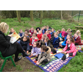 We listened to our new class story in the woods.