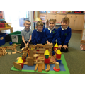 We have used 3D shapes to make a castle.