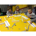 Making colourful worms by ripping paper.