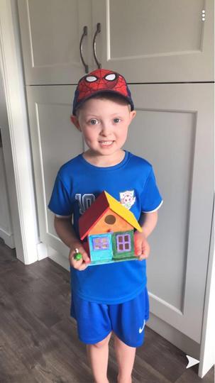 Max and his rainbow birdhouse.