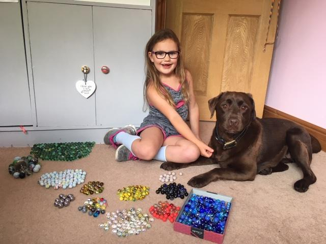 Holly and her dog doing lots of marble sorting!