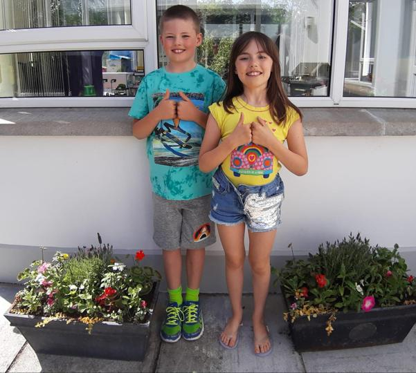 Caitlin & Christopher planted hanging baskets.