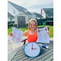 Daisie has been learning to tell the time!