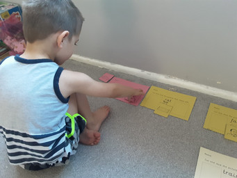 Nathan is matching pictures to words.