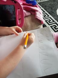 Kelsi writing 'v'.  Good work.