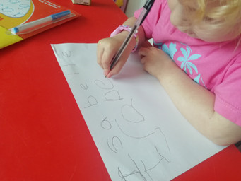 Isabelle is writing her name - excellent.