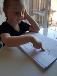 Kelsi learning her 2d shapes.