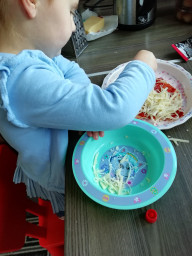 Isabelle busy making her pizzas.