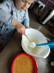 Isabelle is busy making a cheesecake -yum.