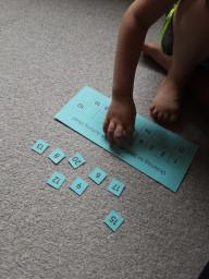 Nathan working on number recognition and ordering.