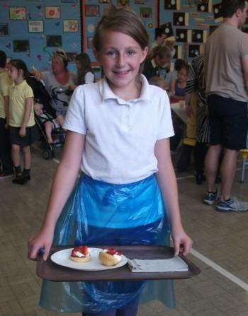 Here is Ellie serving a cream tea with a smile.