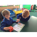 EYFS boys love to investigate number