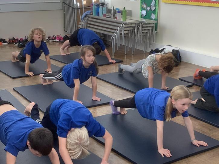 Using yoga moves in gym to improve core strength