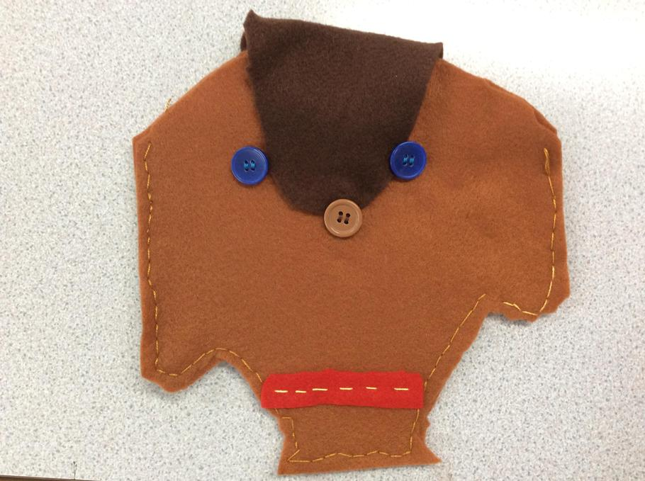 Megan's dog purse with a button fastener.