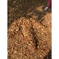 Forest School - making giant dinosaur footprints