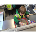 Having a go on the till at Morrisons.