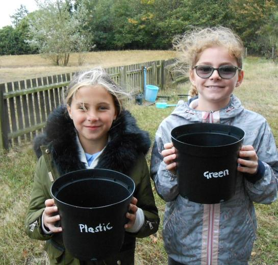 Pupils ready to bury the plastic bags.